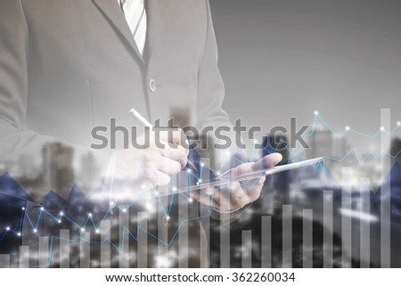 Double exposure of businessman using digital tablet with city landscape blurred background.Forex graph on the business city centre. A metaphor of international financial consulting.investment concept - stock photo