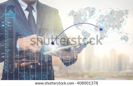 Double exposure of businessman using tablet for connection with cityscape and financial graph on blurred building background,Business Trading concept,Elements of this image furnished by NASA - stock photo