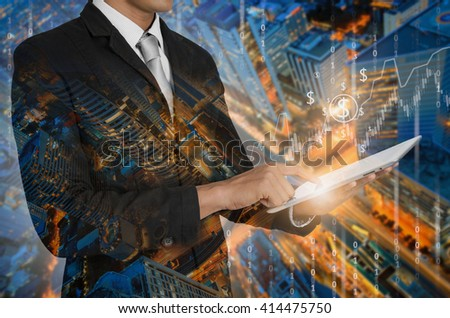 Double Exposure of businessman using tablet with the financial graph on background blurred cityscape. - stock photo