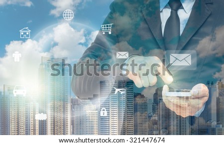 Double exposure of businessman using the smart phone on cityscape background, business concept - stock photo