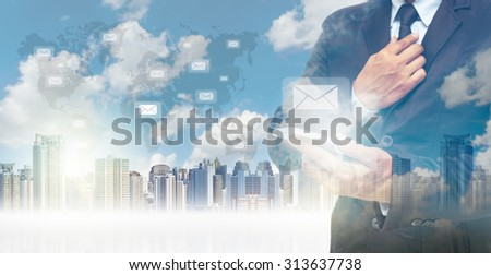 Double exposure of businessman using the tablet for sending the email on world map and cityscape background, business concept,Elements of this image furnished by NASA - stock photo