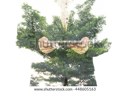 Double Exposure of Businessman with Big Tree and Leaf as Business Network and Technology Concept
