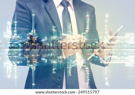 Double exposure of businessman with Petrochemical factory