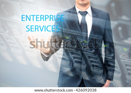 Double exposure of businessman with servers technology in datacenter in IT enterprise services concept - stock photo