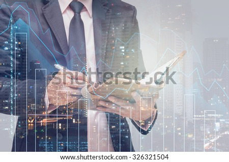 Double exposure of businessman with Trading graph on the cityscape background,Business financial concept - stock photo