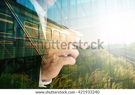 Double Exposure of Businessman writing, Glass decorated Building and Train on Rural Scene with sunrise as Conceptual image - stock photo