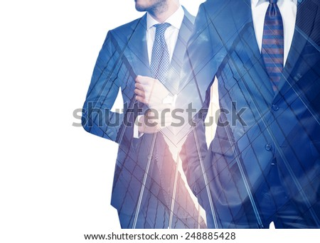 Double exposure of businessmen and skyscraper - stock photo
