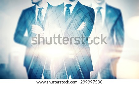 Double exposure of businessmen and skyscraper on megalopolis back - stock photo