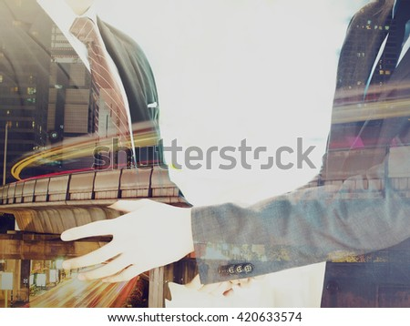 Double Exposure of Businessmen in suit handshaking agreed upon partnership - stock photo