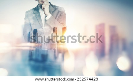 Double exposure of city and business man with light effects - stock photo