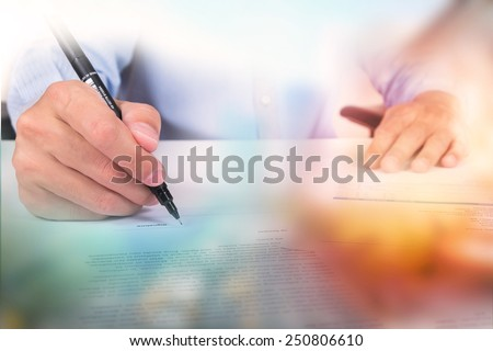 Double exposure of city and businessman sign document - stock photo
