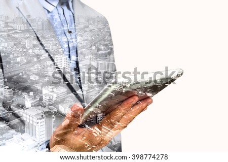 Double exposure of city and hands using digital tablet as Wireless Telecommunication Technology Concept - stock photo