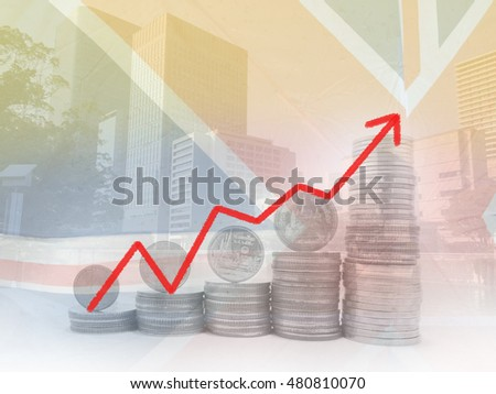 Double exposure of city and row of coins stack with improve profit for finance and banking concept.