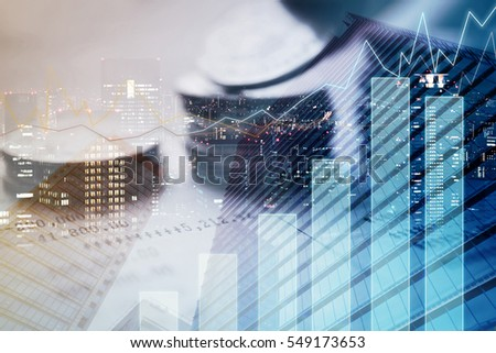Double exposure of city, graph and rows of coins for finance and banking concept
