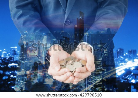 Double exposure of cityscape and businessman collect many coins on hands, finance and banking concept - stock photo