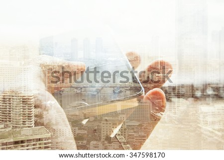 Double exposure of cityscape and smart phone - stock photo