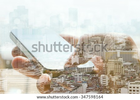 Double exposure of cityscape and smart phone, business technology concept.  - stock photo