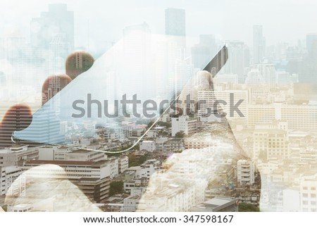 Double exposure of cityscape and smart phone, communication technology concept.