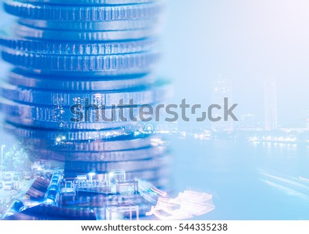 Double exposure of coins and night city background, Finance and banking concept