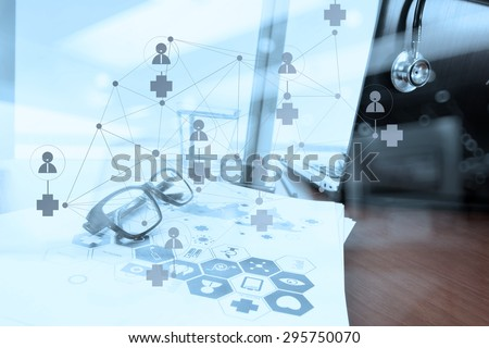 double exposure of Doctor workspace with laptop computer in medical workspace office and medical network media diagram as concept - stock photo