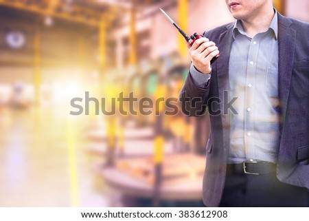 Double exposure of electric engineer using the radio with Manufacturing electrical cables on blurred Manufacturing electrical cables background - stock photo