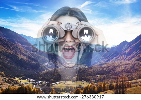 Double exposure of girl looking through binoculars and autumnal landscape