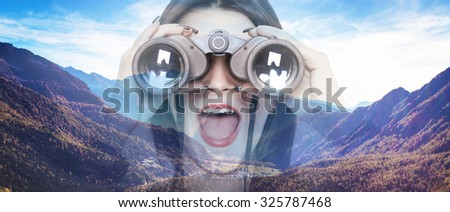 Double exposure of girl looking through binoculars and mountainscape letterbox