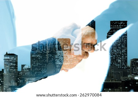 Double exposure of handshake and city - stock photo