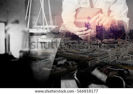 Double exposure of Justice and Law context.Male lawyer hand sitting on sofa and working with smart phone,digital tablet computer docking keyboard on living table at home,London architecture city