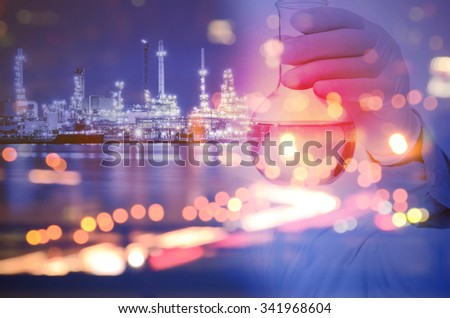 Double exposure of laboratory test tube and Oil refinery plant - stock photo