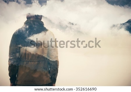 Double Exposure of Man and Cloudy Mountains forest Travel Lifestyle conceptual background - stock photo