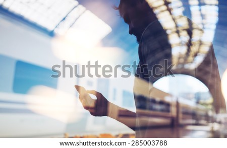 Double exposure of man and smart phone - stock photo