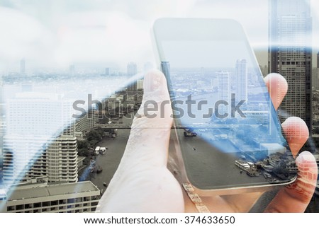 Double exposure of man using smart phone and cityscape background, urban lifestyle and Business technology concept. - stock photo