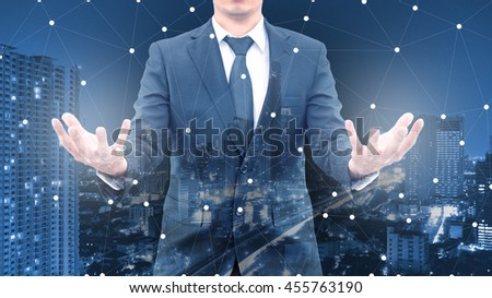 Double exposure of professional businessman and network connection with cityscpae in communication , technology and business concept - stock photo