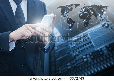 Double exposure of professional businessman connecting internet smart phone with servers technology and connect world network in IT Business concept, element of this image furnished by NASA