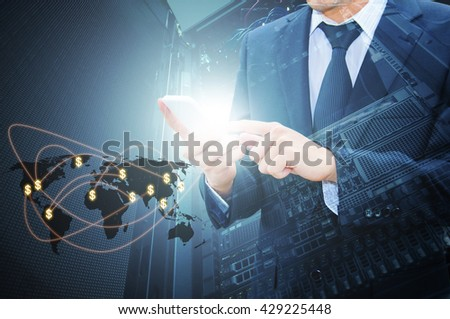 Double exposure of professional businessman using cloud in smart phone with servers in data center and world map network connection in IT Technology, Business and Finance concept, world map from NASA - stock photo