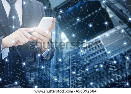 Double exposure of professional businessman using smart phone and network connection with blurred server datacenter and cityscape in communication , technology and business concept - stock photo