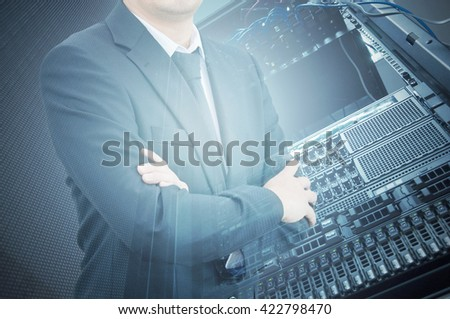 Double exposure of professional businessman with servers technology in data center in IT business concept - stock photo