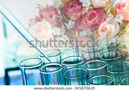 double exposure of science laboratory test tubes and flower , natural research concept - stock photo