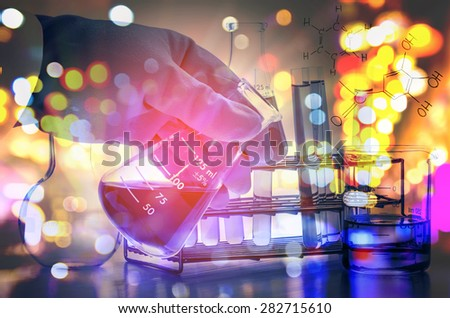 Double exposure of scientist hand holding laboratory test tube  - stock photo
