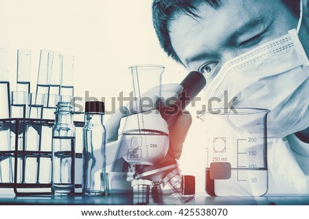 Double exposure of scientist using microscope with lab glassware background, Laboratory research concept - stock photo