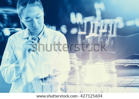 Double exposure of Scientists or doctor is thinking for writing report with Laboratory glassware containing chemical liquid, science research concept,vintage process style - stock photo