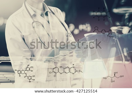 Double exposure of Scientists or doctor is writing report with Laboratory glassware containing chemical liquid, science research concept,vintage process style - stock photo