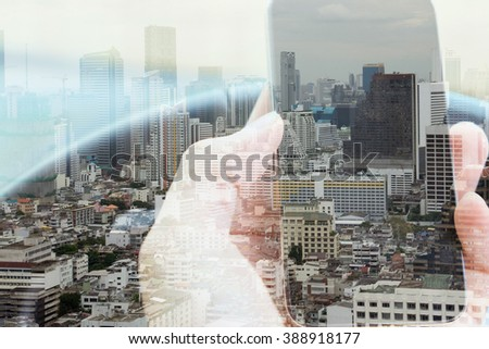 Double exposure of smart phone and cityscape background, urban lifestyle and communication technology concept.