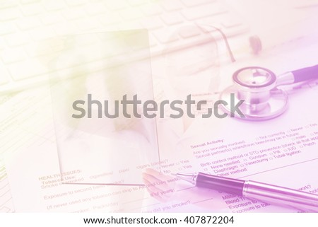 Double exposure of stethoscope,pen,and  health form ,medical and insurance  background