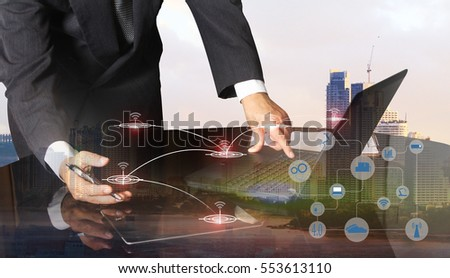 Double exposure of success businessman using digital tablet with social media network diagram,internet concept,business persons are developing a project using virtual reality for industry 4.0