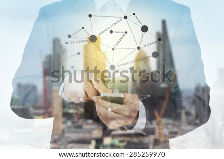 Double exposure of success businessman using smart phone with abstract building and social media diagram - stock photo
