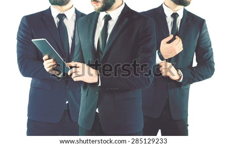 Double exposure of three businessmen