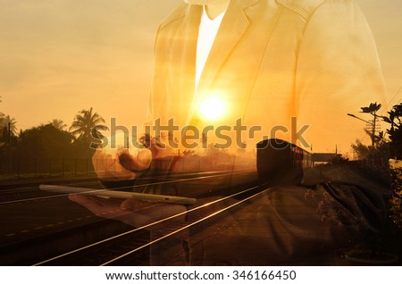 Double exposure of Train Station with Railway and businessman with Tablet or Wireless Device as Business development concept. - stock photo