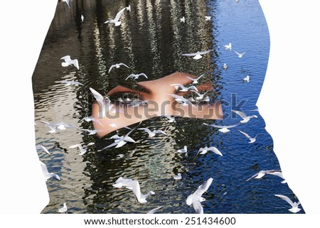 Double exposure of woman wearing burqa and seagulls - stock photo